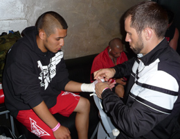 REPUBLIC Coach Dave Nielsen wraps his fighter Jose's hands before Muay Thai Kickboxing title fight at Battle of the Comicon.