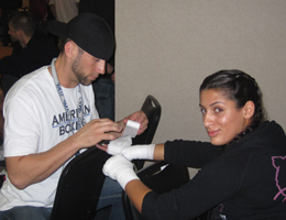 REPUBLIC Coach Dave Nielsen wraps his amateur fighters hands before Muay Thai Kickboxing competition