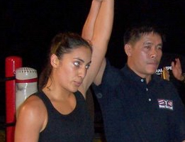Gina Reyes San Diego Muay Thai Boxer fight winning photo